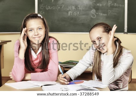 Educational theme: schoolchildren in a classroom.