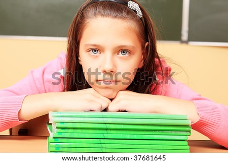 Educational theme: schoolgirl in a classroom.