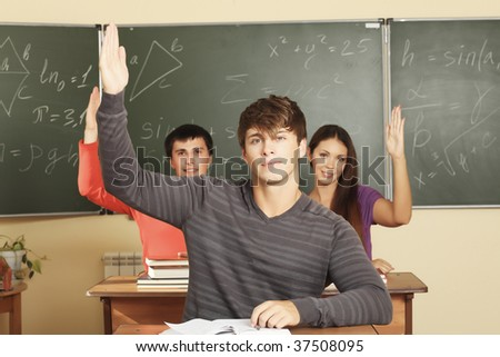 Educational theme: students in a classroom. - stock photo