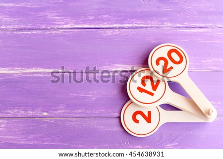 Educational toy to teach children numbers. Learning toy for kids on lilac wooden background with empty space for text. Teaching numbers to preschoolers fun  - stock photo