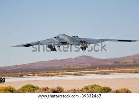 "EDWARDS AFB, CA - OCTOBER 17: Northrop Grumman B-2 Spirit ""Spirit Of New York"" takes off at Flight Test Nation 2009, October 17, 2009, Edwards Air Force Base, CA - stock photo"