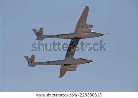 EDWARDS AFB, CA/USA - OCTOBER 17: Scaled Composites White Knight Two flyover at Flight Test Nation 2009 is shown on October 17, 2009 at Edwards Air Force Base, CA/USA.  - stock photo