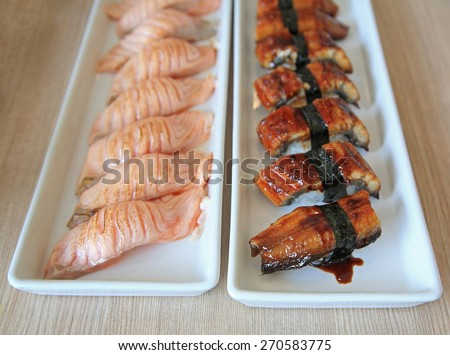 Eel and Salmon sushi Rolls, Traditional japanese food - stock photo