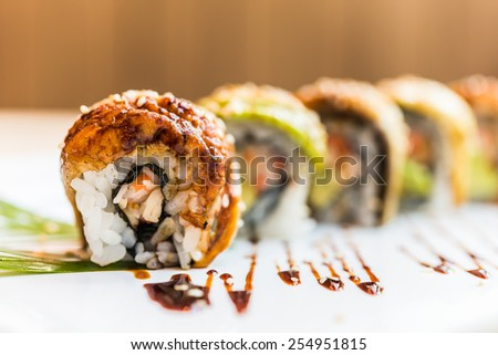 Eel fish sushi roll maki - japanese food - selective focus - stock photo