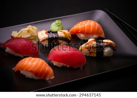 Eel, salmon and tuna sushi with chopsticks, top view - stock photo