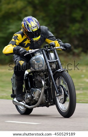 EELMORE, UK - SEPTEMBER 29: An unnamed rider takes his vintage Triumph motorcycle out of the apex of a bend at the VMCC Ossie Neal Memorial Sprint race on September 29, 2013 in Eelmore