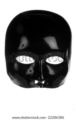 Eerie black face mask isolated on white background - stock photo