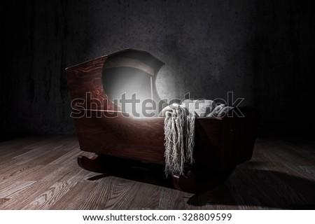 Eerie Cradle. Low key lighting - stock photo