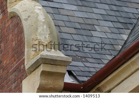 Effects of rain erosion on a 1870's building.  Possibly acid rain damage. - stock photo