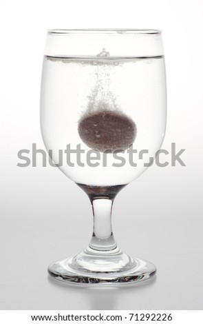 Effervescent bubbling in glass - stock photo
