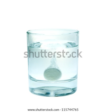 Effervescent tablet splashing into a glass full of water