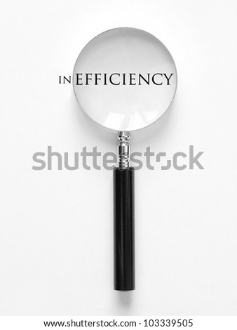 efficiency and magnifying glass - stock photo