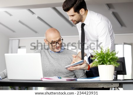 Efficiency sales team with laptop and tablet working on project at office.   - stock photo