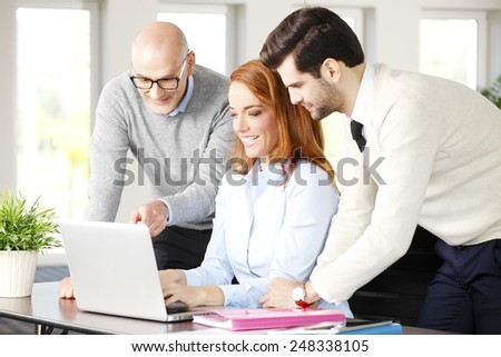 Efficiency sales team working on project while sitting at office in front of computer. Teamwork at office.  - stock photo