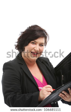 Efficient personal assistant smiling attentively as she waits for your dictation to take notes - stock photo
