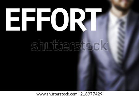 Effort written on a board with a business man on background - stock photo