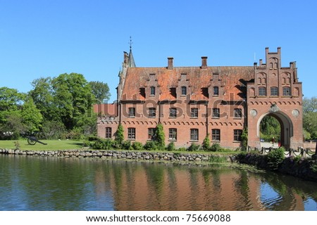 Egeskov castle and cannon, landmark fairy tale castle in Denmark