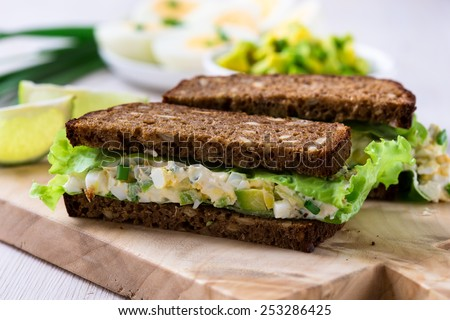 Egg and avocado sandwiches with cream cheese for healthy breakfast - stock photo