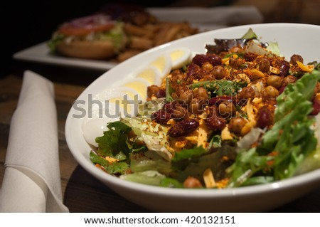 Egg and Bean Salad with balsamic vinaigrette appetizer on table. - stock photo