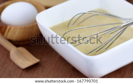 Egg beater in a kitchen for preparing meal - stock photo