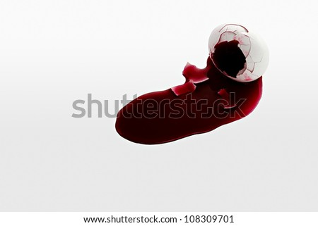 Egg bleeding blood - stock photo