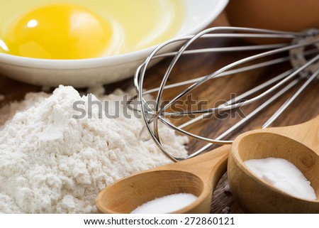 egg, flour and ingredients for baking, close-up, horizontal - stock photo