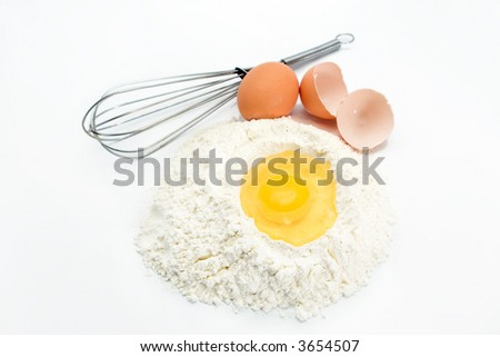 egg flour and kitchen utensil - stock photo