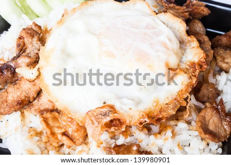 Egg fried and fried pork garlic with soy sauce topped on rice