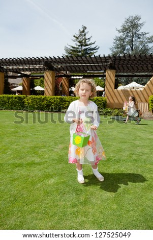 Egg hunt is a game during which decorated eggs, real hard-boiled ones or artificial, filled with or made of chocolate  candies, of various sizes, are hidden in various places for children to find. - stock photo
