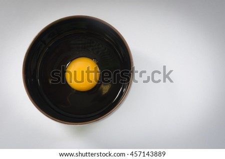 egg in a bowl,prepare food. - stock photo