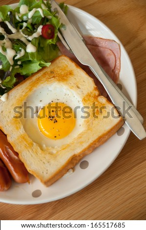 Egg in a hole is breakfast menu of American - stock photo