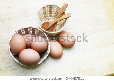 egg in basket on wood table