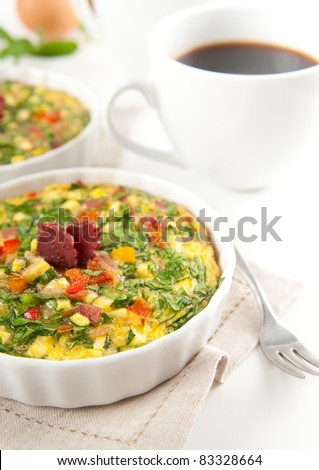 Egg Muffin with Lots of Organic Vegetables and Pepperoni - stock photo