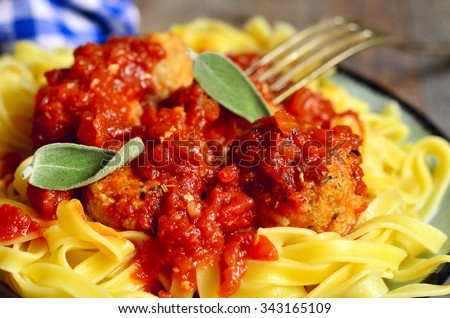 Egg noodle with homemade chicken meatballs.Rustic style. - stock photo