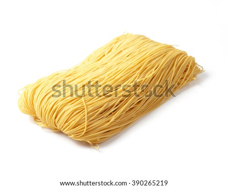 Egg noodles on a white background