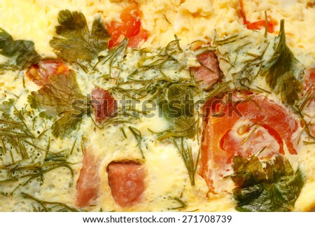 Egg omelette with tomatoes, sausages and dill - stock photo