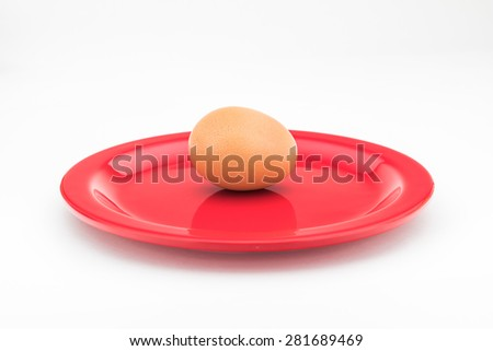 egg on red dish isolated on white