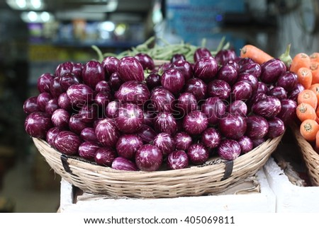 egg plant in bucket with shallow depth of field - stock photo