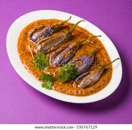 egg plant south indian curry, brinjal curry, brinjal masala also known as baigan masala or baingan masala in India, spicy and tasty dish served with chapati, main course - stock photo