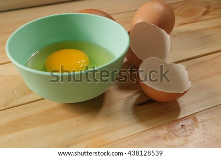 egg prepare cook omelette and egg shell on wood background  - stock photo