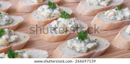 Egg Salad Hors d'Oeuvres - Egg salad served on slices of a baguette. - stock photo