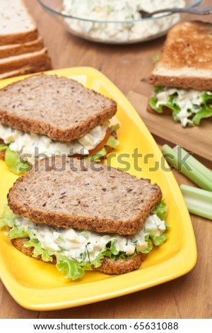egg salad sandwiches on brown toasted bread and ingredients - stock photo