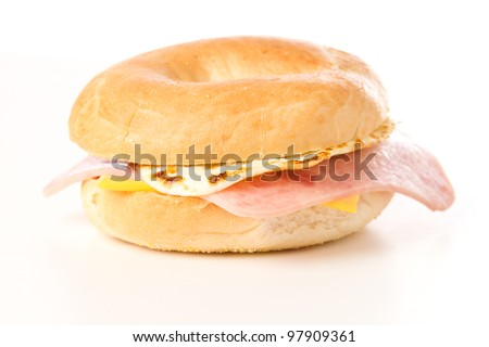 Egg Sandwich / This is a photo of a delicious egg ham and cheese sandwich on a toasted bagel. Shot on a white background. - stock photo