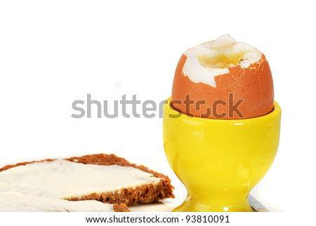Egg, softboiled and rye bread - stock photo