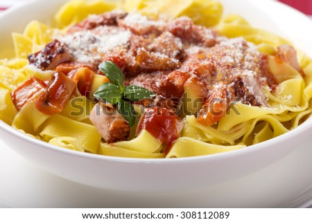 Egg tagliatelle with meat in tomato sauce - stock photo