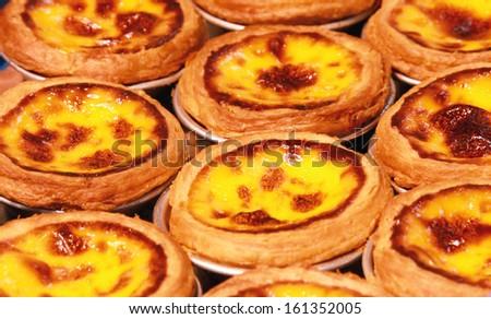 egg tarts in tray - stock photo