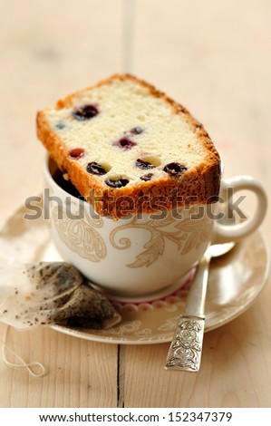 Egg White Cake with Berries with a Cup of Tea - stock photo