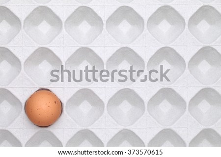 egg with package background, paper box top view  - stock photo