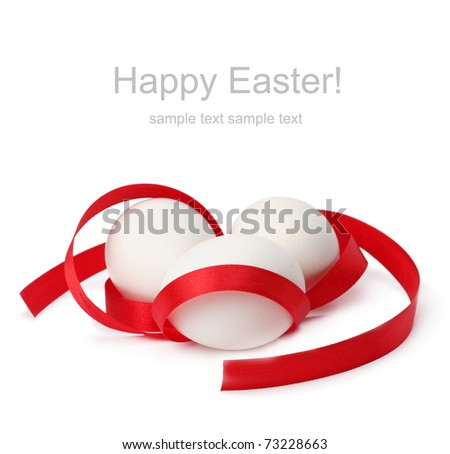 egg with red ribbon
