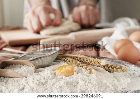Egg yolk in flour close up on a wooden table. Rural or rustic style. Copy space. Free space for text - stock photo